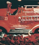 Groom's cake shaped like red firefighter truck
