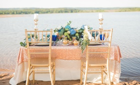 sweetheart table on the lake shore, styled shoot sequin linen on sand