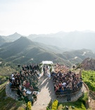 Malibu Rocky Oaks Vineyard Estate wedding ceremony on helipad overlooking Santa Monica mountains