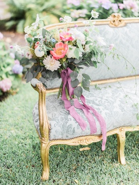 bohemian bouquet on Victorian antique settee styled wedding shoot