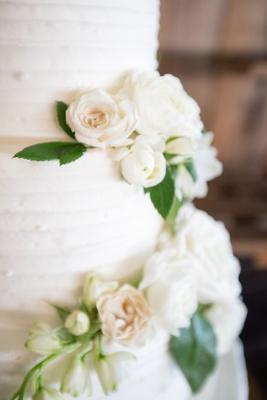 Echosmith singer Sydney Sierota and Cameron Quiseng wedding cake buttercream frosting fresh flowers