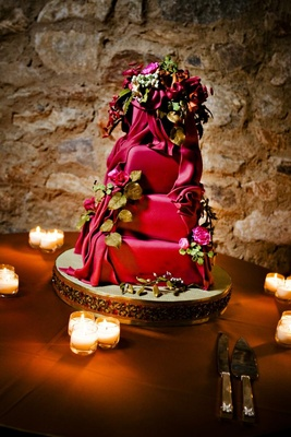Brightly colored wedding cake with flower decorations