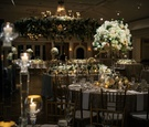 Wedding reception with round and rectangular tables white flowers greenery candles winter decor idea