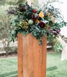 colorful floral arrangement altar ceremony southern california boho winter wedding styled shoot