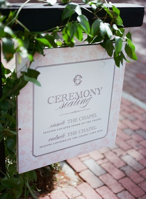 wedding ceremony sign directing guests inside chapel and on the lawn to witness the ceremony