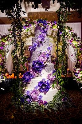 34b2fa1d2cd ... Wedding cake six layer purple flowers white fondant silver pearls  greenery reception ideas swing ...