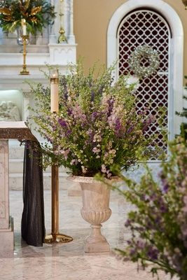 church wedding with floral display of purple flowers and greenery
