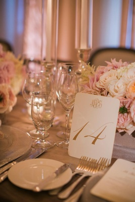 Wedding reception white and gold monogram table number