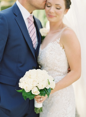 destination wedding in lake como illusion wedding dress willowby watters groom navy suit white roses