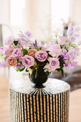 flower arrangement roses in shades of pink and lavender sweet peas, dark vase