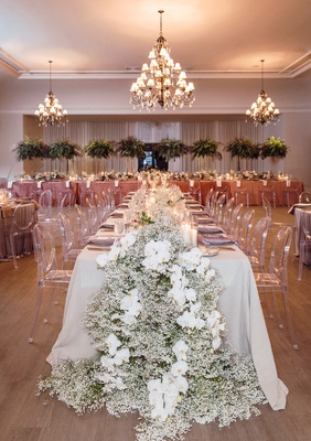 The bath club miami wedding, taupe linens, dusty rose linens, ghost chairs, baby's breath and orchid