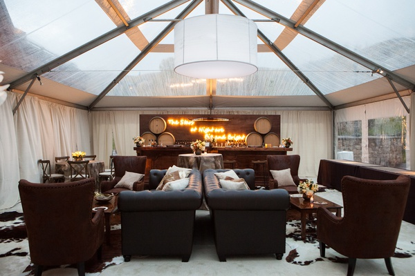 tented area for large wedding, men's lounge, masculine lounge area at wedding