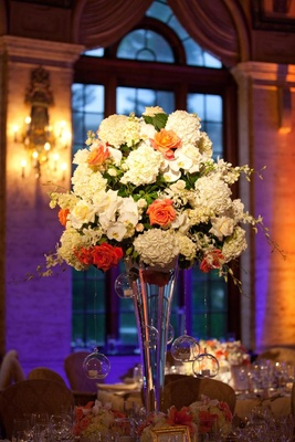 White and orange flower wedding centerpiece