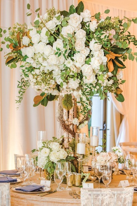 wedding reception centerpiece birch tree trunk growing into white roses with greenery