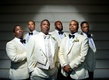 Tracy Morgan and his groomsmen at wedding in white ivory tuxedos and black bow ties