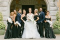 bride in hayley paige, bridesmaids in black lazaro and amsale, bridesmen in ike behar