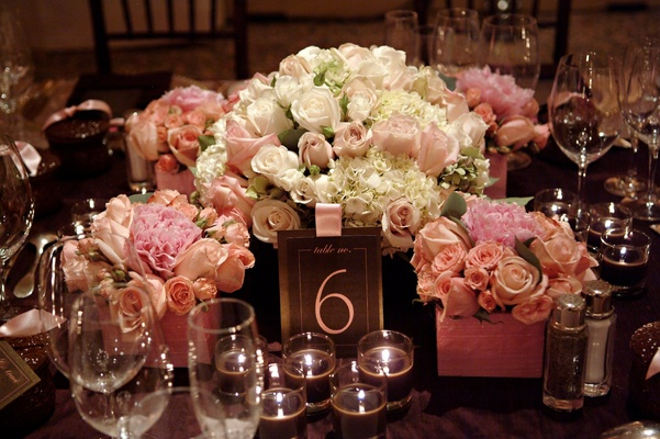 Table card with votive candles and flowers