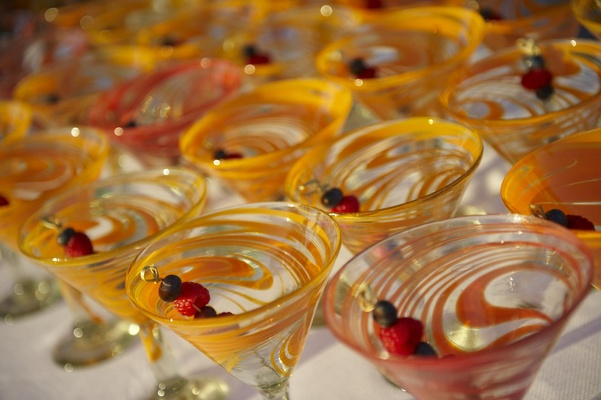 Wedding reception martini glasses with berry skewers