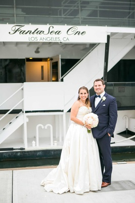 bride in allure ball gown, groom in navy joseph abboud suit