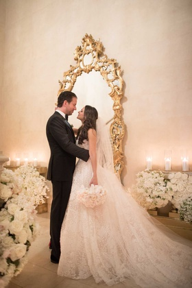 wedding portrait bride and groom long hair gold mirror white flowers candles the plaza hotel
