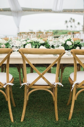 Wedding reception montage kapalua bay lawn wood vineyard chair cushion green garland on table low