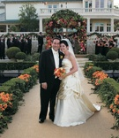 Bride in a strapless gown with a pickup skirt and groom in black tuxedo