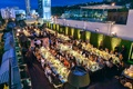Rooftop wedding reception location The London West Hollywood overlooking Los Angeles at twilight