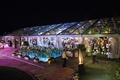 A-line roof plexiglas tent over pool of country club at night