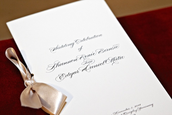 Simple wedding program with tan satin ribbon