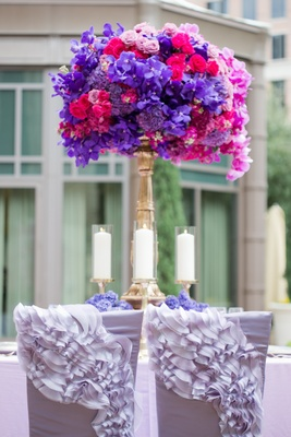 Wedding reception chairs with light purple, ruffled chair sleeves