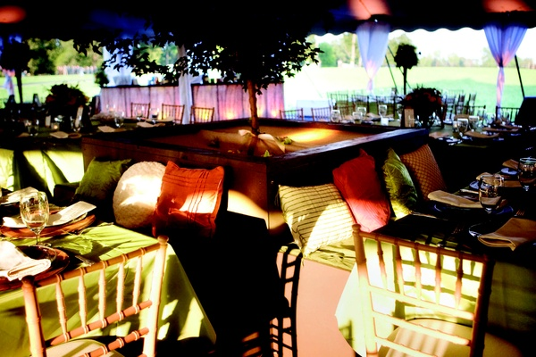 Wedding reception seating with colorful pillows