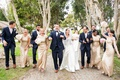 bride in allure ball gown, groom in navy joseph abboud suit, bridesmaids in gold sorella vita
