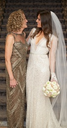 Bride in Inbal Dror wedding dress long sleeve with mother of bride in illusion gold geometric dress
