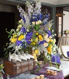 grand purple yellow arrangement display new york city bridal shower trunk bottles
