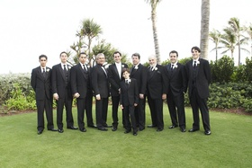 Groom with male attendants on The Breakers lawn