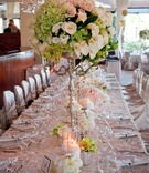 Candelabra centerpieces with calla lilies and orchids
