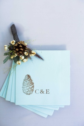 custom blue napkins couples initials pinecone in gold tan champagne