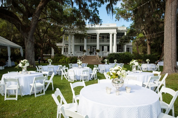 outdoor dinner tables in addition to tented reception