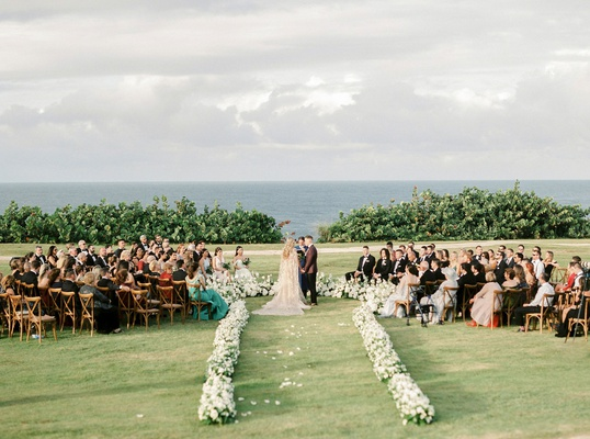 outdoor wedding ceremony puerto rico fort ocean mariana vicente kike hernandez in the round seating