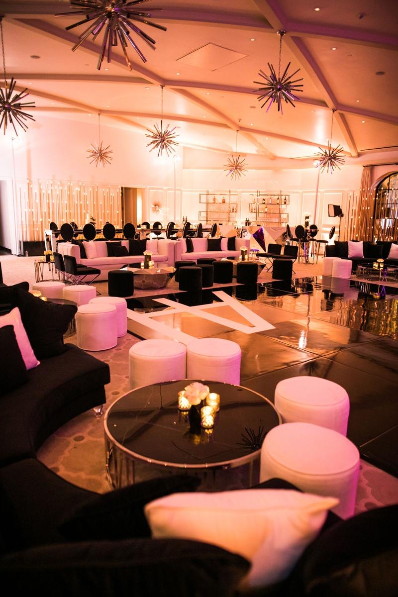 wedding reception ballroom for dancing black white lounge furniture gold metallic elements ottomans