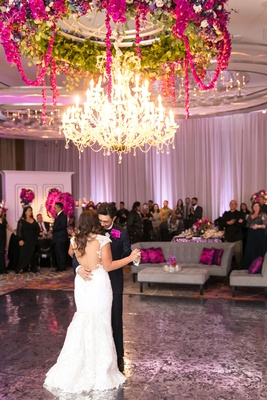 bride in cristiano lucci wedding dress with open back, first dance under chandelier