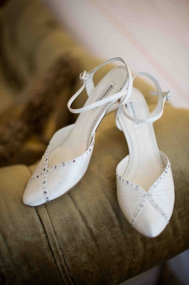 Bride's satin shoes subtly embellished with crystals