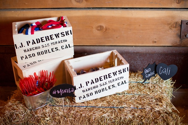 Wooden crates filled with fourth of july themed favors.