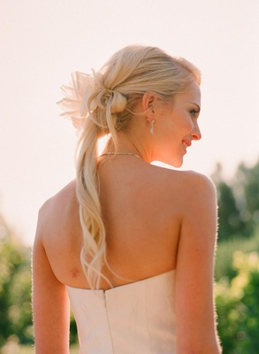 Bride with flower in hair and thin curls