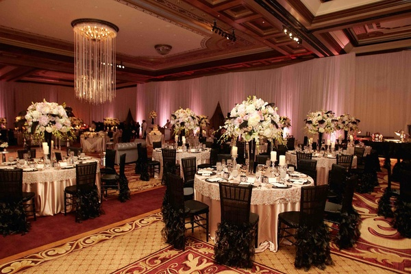 ... Ballroom Tables Surrounded By Black Chair Covers ...