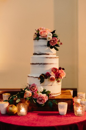 semi-naked cake, lightly frosted three-tiered cake with fresh flowers