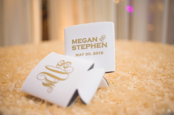 Ivory koozies with bride and groom's names, monogram, wedding date in gold lettering