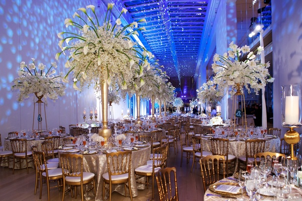 A dream winter wedding at the art institute of chicago inside weddings wedding reception tables with tall gold trumpet vases and white flowers mightylinksfo