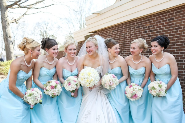 Bride with bridesmaids holding romantic bouquets