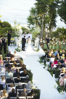 Wedding ceremony on bluff over ocean with bamboo details